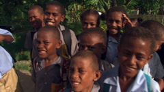 Close-up of Fijian children laughing and making funny faces - stock footage