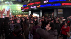 Crowd Looking up Celebrating after 2012 Election Night Stock Footage