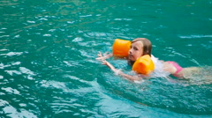 Girl swimming in the lake Stock Footage