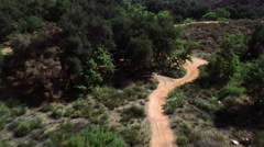 Close, fast flight over rough terrain. Shot in 2002. - stock footage