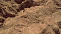 Low, fast flight over eroded landscape. Shot in 2002. Stock Footage