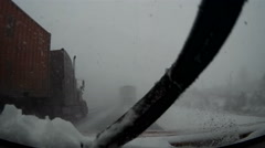 POV dashcam driving in snowstorm and snow covered highway in blizzard Stock Footage