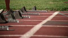 Close-up of starting blocks and racers' feet Stock Footage