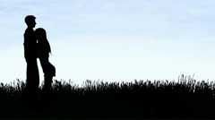 Man and woman hugging in the tall grass Stock Footage
