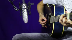 Playing Acoustic Guitar in Studio - stock footage