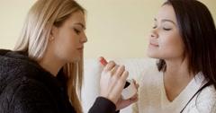 Beautiful makeup artist working Stock Footage