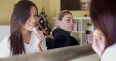Girls Putting Make-up In Front of a Mirror Stock Footage