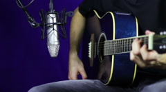 Recording Acoustic Guitar in the Studio - stock footage