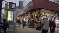 Busy Canal Street in Chinatown early evening on corner in winter 4K NYC Stock Footage