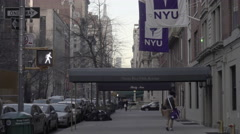 Student walking into NYU dormatory Sam Rubin at 35 5th Ave in 4K NYC Stock Footage