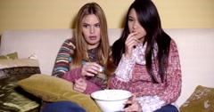 Frightened Girls Watching Horror Movie at Home Stock Footage