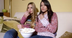 Girls Covering Faces While Watching Horror Movie Stock Footage