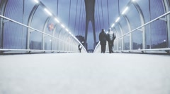 Slow people walking on a futuristic walkway bridge in the city Stock Footage