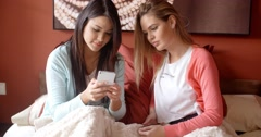 Cute woman showing friend her phone Stock Footage
