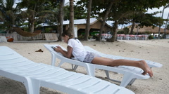 Young girl with tablet pc at the beach Arkistovideo