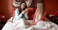 Pretty Girls Chatting in Bedroom Before Sleeping Stock Footage