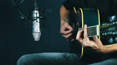 Recording Acoustic Guitar in the Studio Stock Footage