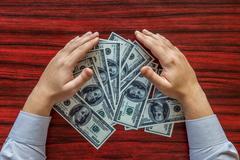 Grabbing money Stock Photos