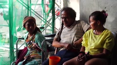 Blind Man begs with Two Female Beggars Stock Footage