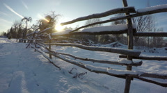 Sunset through wooden handmade fence in winter's evening, time lapse 4K Stock Footage