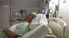 Mature Male Patient Resting In Hospital Bed Stock Footage