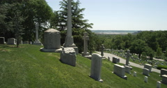 Right pan over non-military grave markers on a hillside in Arlington National - stock footage