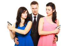 Jealousy between women relationship in triangle. Stock Photos