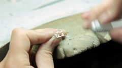 Jeweler making gold jewelry by hand polishing it. Stock Footage