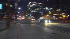 Cars traffic Hollywood Blvd at night, La Brea Avenue intersection Los Angeles - stock footage