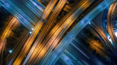 Static vertical top down aerial view of traffic freeway interchange at night 4K Stock Footage