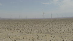 AERIAL: Windmills Producing Electricity in the Desert, California Stock Footage