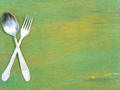 Fork and spoon on old wood Stock Photos