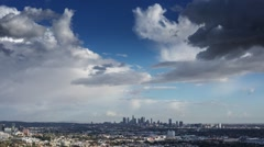 Dramatic storm clouds over city Los Angeles skyline zoom in downtown Timelapse Stock Footage