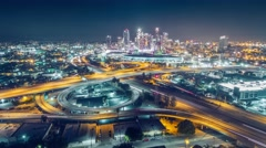 Aerial view freeway interchange downtown Los Angeles skyline night timelapse 4K Arkistovideo