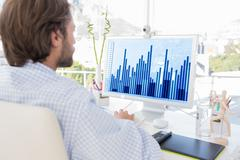 Composite image of desinger working on his computer - stock photo