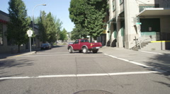 Front view of a Driving Plate: Car turns right from NW Davis Street in Portland, Stock Footage