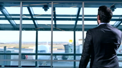 4K Business Man in Suit waits to board Airplane at Airport Terminal Gate Stock Footage