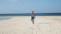 Girl in silk tunic walking on the beach Stock Footage