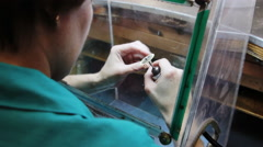 Hand polishing gold jewelry ring jeweler. Stock Footage