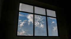 Time lapse shot of old windows with clouds moving in background, 4k - stock footage