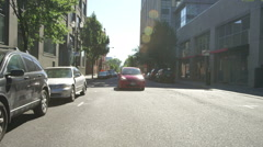 Rear view of a Driving Plate: Car turns right from NW Davis Street in Portland, Stock Footage