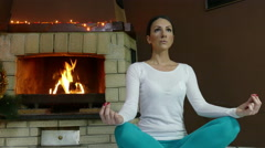 Sexy Woman in blue pants  Practicing Yoga In Front Of Fire Place At Home 4K Stock Footage