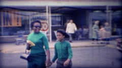 1971: African mother daughter leave grocery store 10 cent bananas! Stock Footage