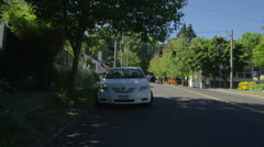 Rear view of a Driving Plate: Car travels north on SW Vista Avenue in Portland, Stock Footage
