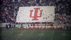 1971: Indiana university football crowd participation makes team logo. Stock Footage