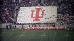 1971: Indiana university football crowd participation makes team logo. - stock footage