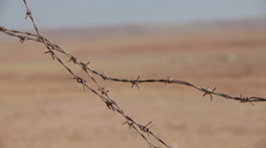 Barbed wire. Tank rides in the desert. Stock Footage