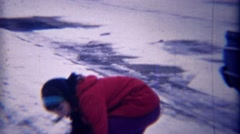 1971: Mixed race girl friends winter snowball fight closeup. Stock Footage
