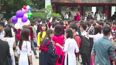 Students at the temple of Literature in graduation day Stock Footage