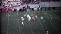 1971: College football game passing touchdown score. - stock footage